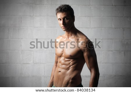 Handsome brawny young man - stock photo