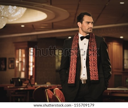 Handsome brunette wearing suit in luxury interior  - stock photo