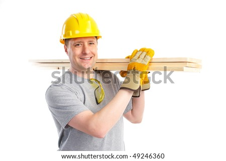Handsome builder with wood planks. Isolated over white background - stock photo