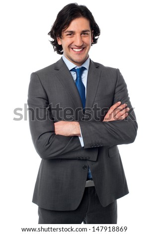 Handsome business executive, arms crossed - stock photo
