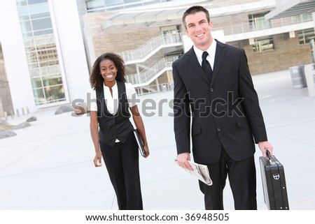 Handsome business man at the office with african co-worker in the background - stock photo