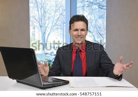 Handsome business man banker or salesman with a computer