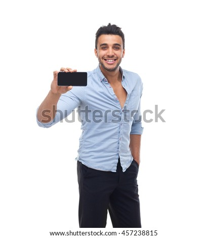 Handsome business man displaying mobile cell smart phone application screen happy smile, businessman wear blue shirt isolated over white background - stock photo