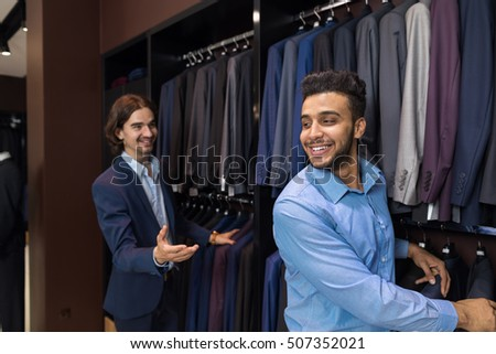 Handsome Business Man Fashion Shop, Customers Choosing Suit Clothes In Retail Store Young People Shopping Formal Wear