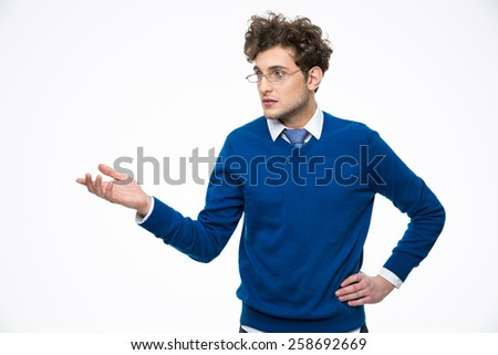Handsome business man in glasses presenting something on the hand - stock photo