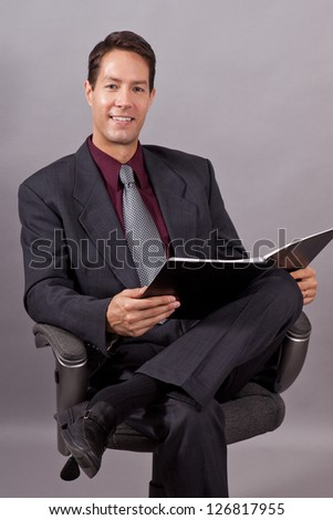 Handsome business man isolated on gray