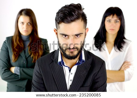 Handsome business man looking with two women isolated - stock photo