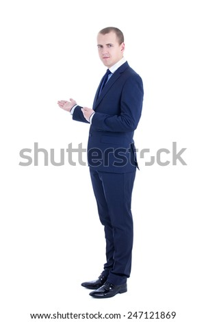 handsome business man presenting a copyspace isolated on white background - stock photo
