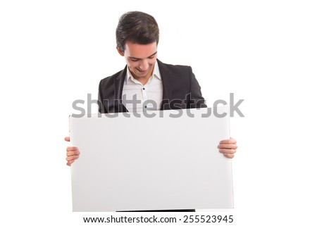Handsome business man presenting your product on a white board - stock photo