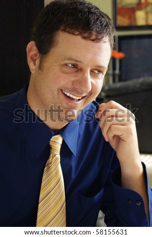 Handsome Business Man Smiling - stock photo
