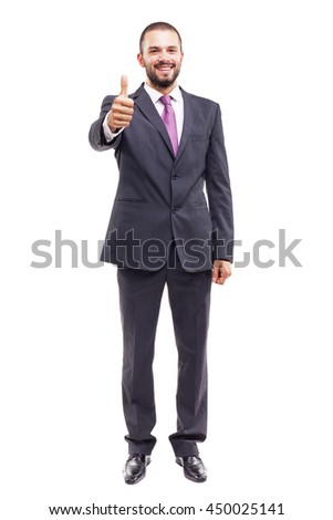 Handsome business man thumbs up, isolated on white background - stock photo
