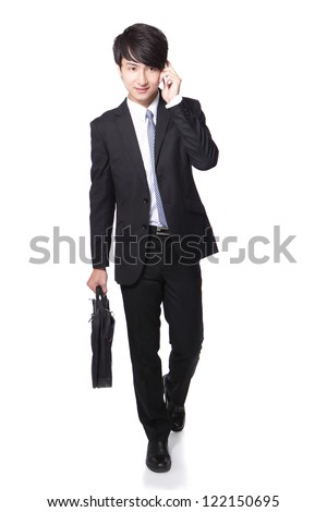 handsome Business man Walking forward while talking on the phone in full length isolated over white background, model is a asian people - stock photo