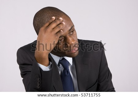 Handsome business man with a depressed expression - stock photo