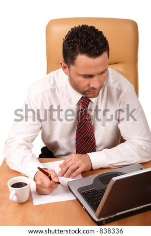 handsome business man working with laptop in his office - isolated