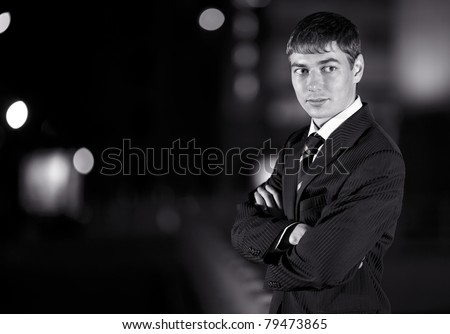Handsome businessman and at night city in the background - wb image - stock photo