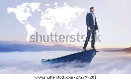 Handsome businessman and cloud world map - stock photo
