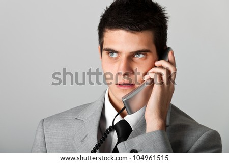 Handsome businessman at phone - stock photo