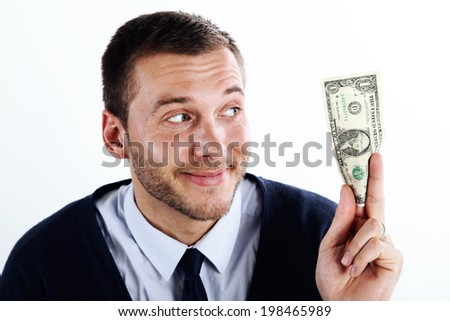 Handsome businessman being happy holding money - stock photo