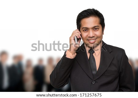 handsome businessman calling by the phone - stock photo