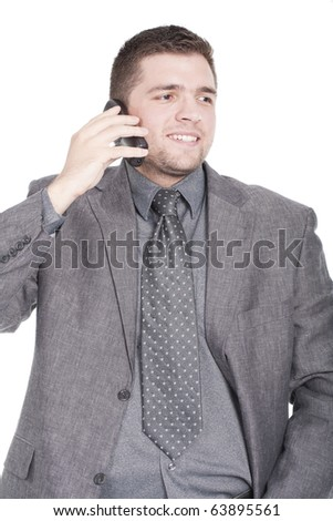handsome businessman calling on mobile phone - stock photo