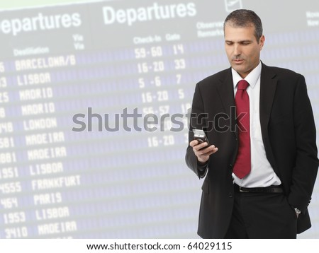 handsome businessman calling on mobile phone on airport - stock photo