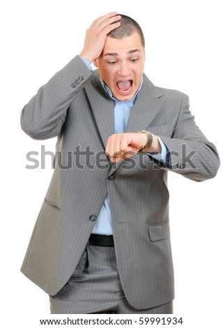 Handsome businessman checking his wrist-watch - stock photo