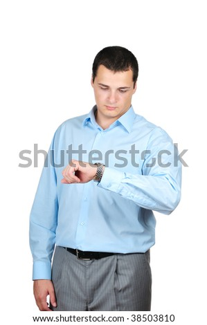 Handsome businessman checking his wrist-watch isolated on white - stock photo