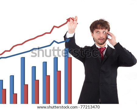 Handsome businessman drawing a graph