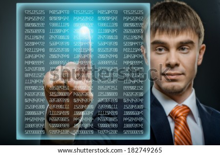handsome businessman  finger point touch  sensor panel, on dark blue background - stock photo