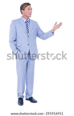 Handsome businessman gesturing with hands on a white background - stock photo