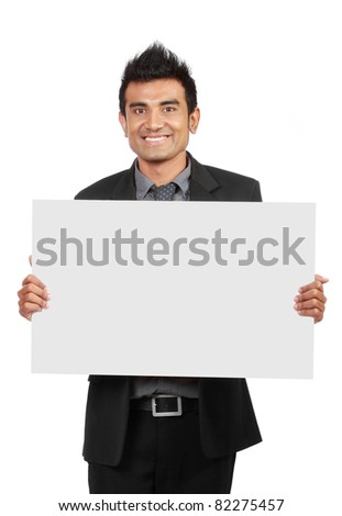 Handsome Businessman holding a blank board isolated on white background