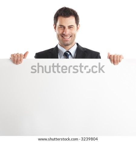 Handsome Businessman holding a blank sign in front of him - stock photo