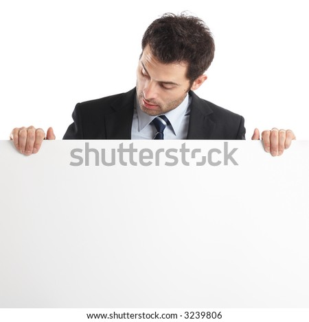 Handsome Businessman holding a blank sign in front of him - check my portfolio for more photos - stock photo