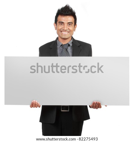 Handsome Businessman holding a blank sign isolated on white background