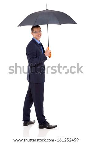 handsome businessman holding an umbrella - stock photo