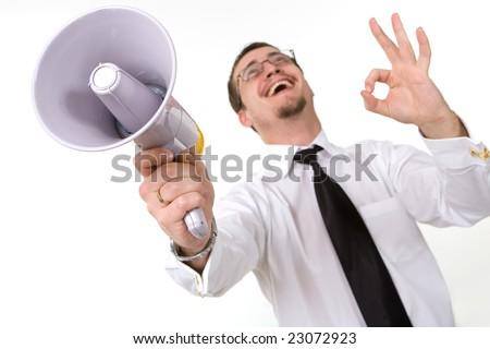 Handsome businessman holding megaphone trumpet, isolated - stock photo