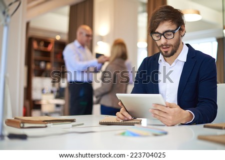 Handsome businessman in casual networking on background of his partners - stock photo
