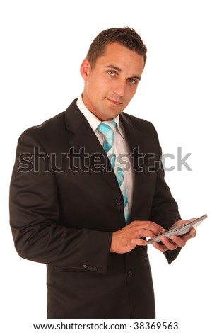 Handsome businessman in suit and tie with calculator in hand