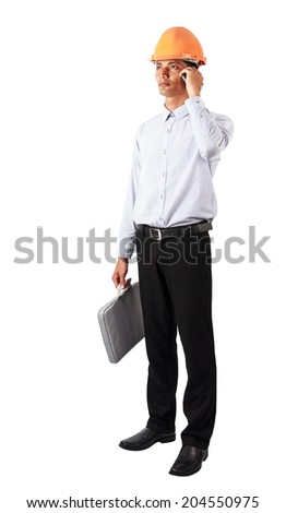 Handsome businessman in suit  speaking on the phone on white background and clipping path. - stock photo