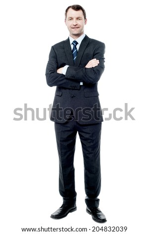 Handsome businessman in suit with crossed arms - stock photo