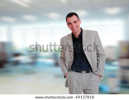 handsome businessman in the office - stock photo