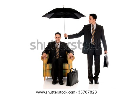 Handsome businessman,  insurance agent sitting in sofa, two faces.  Studio, white background. - stock photo