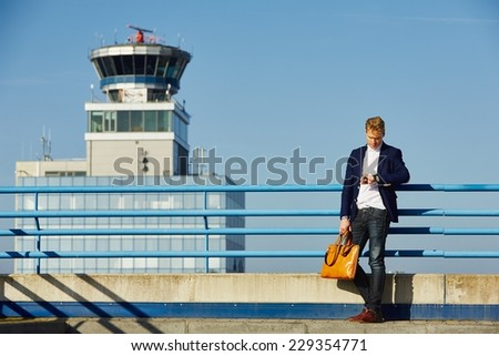 Handsome businessman is waiting at the airport  - stock photo