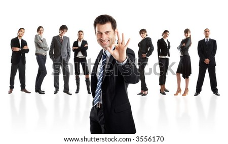 Handsome Businessman Leader very happy about the results with his team behind - all in focus - check my portfolio for similar photos - stock photo