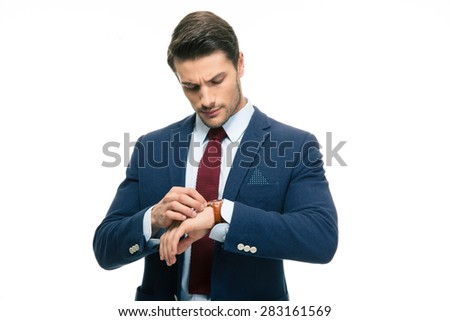 Handsome businessman looking on his wrist watch isolated on a white background - stock photo