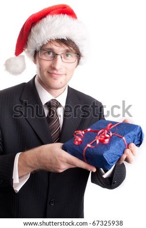 Handsome businessman offering a christmas gift - stock photo