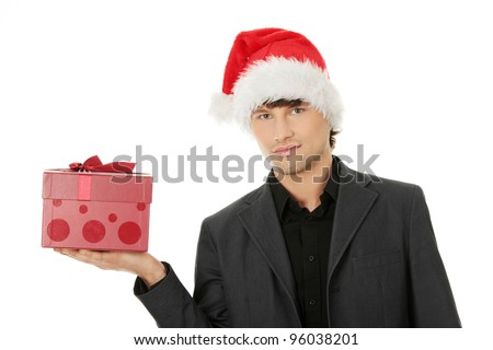 Handsome businessman offering a christmas gift. Isolated on white background - stock photo