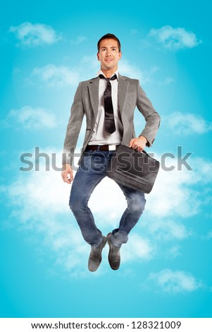 Handsome businessman on the clouds / Young businessman jumping with briefcase