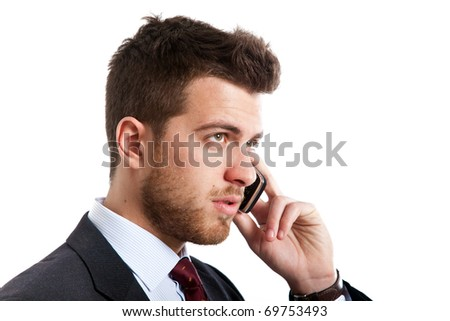 Handsome businessman on the phone isolated on white - stock photo