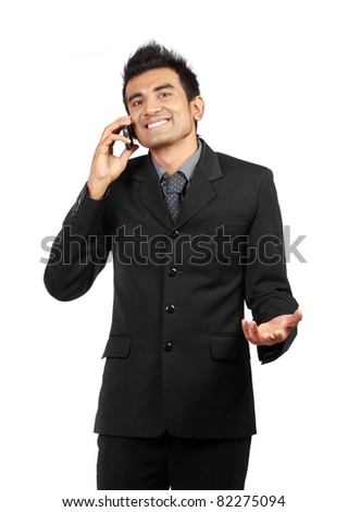 Handsome businessman on the phone. isolated on white - stock photo